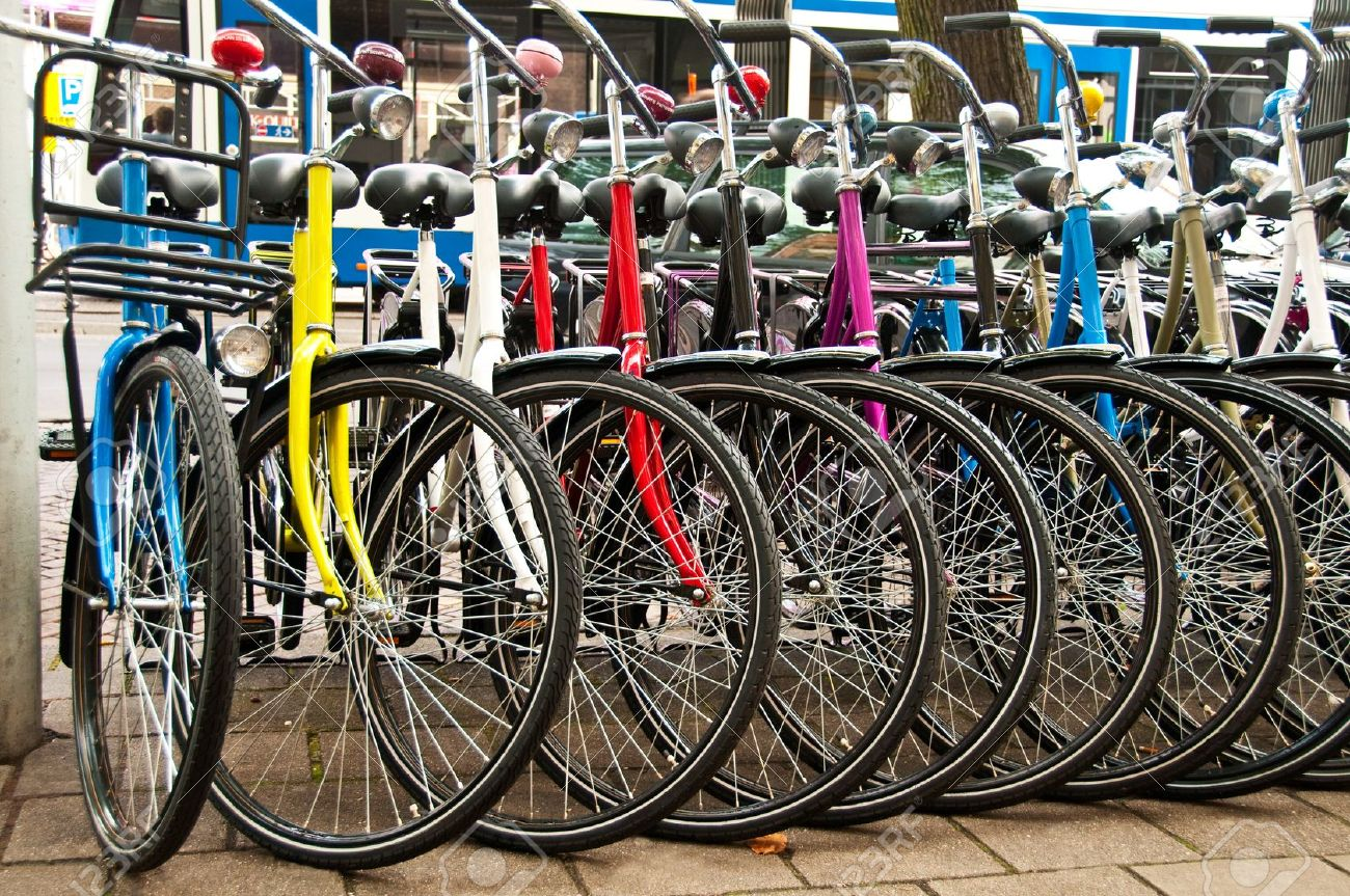 11707663-Row-of-parked-colorful-bicycles--Stock-Photo-bicycle-bike-shop